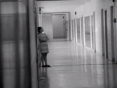 A student gets a rare moment to herself in the hallway.