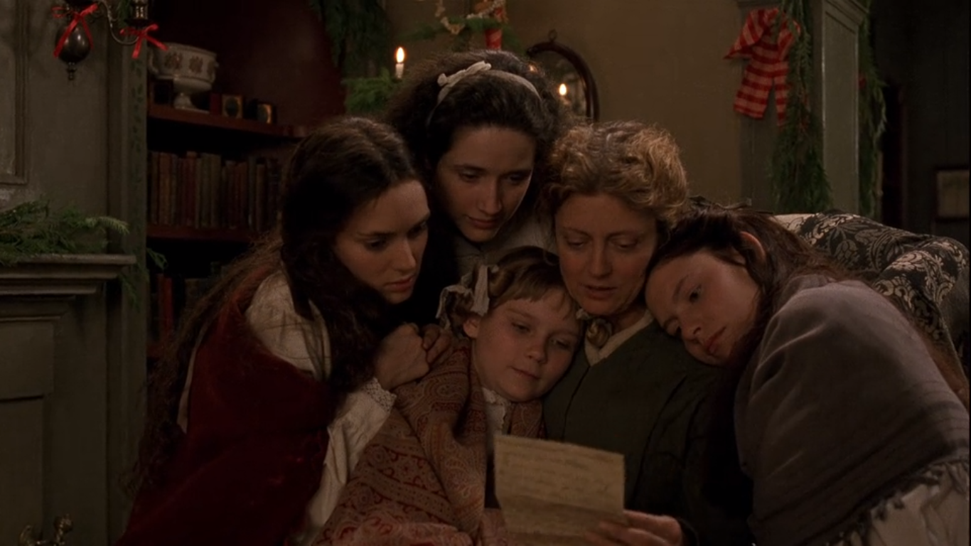 Mrs. March reads a letter from her husband to her four daughters in a scene from Little Women.