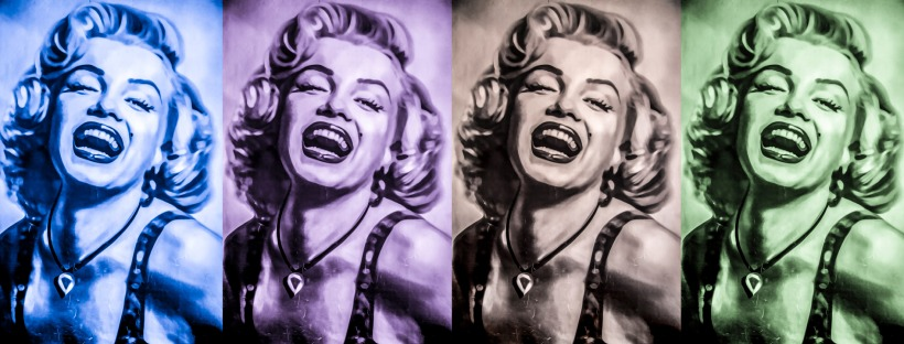 Four identical side-by-side portraits of Marilyn Monroe smiling.